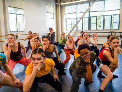 Dance Students in a tight group holding their faces at a BODYTRAFFIC summer intensive