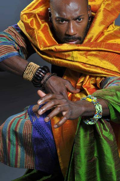 Carlton Wilborn in movement, wearing colorful draping clothes