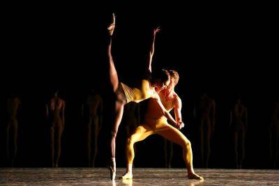 ballet duet: one female on pointe in a side penché held by partner