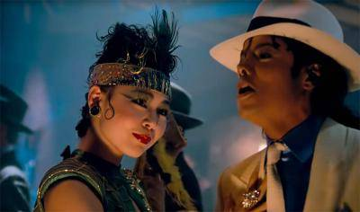 Cindera Che as Madam in Michael Jackson's Smooth Criminal music video