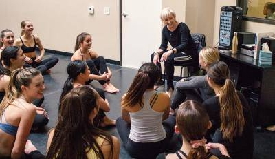 Paula Kessinger laughing with her group of dance students