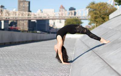 Lindsay Janisse in a variation of the Upward Facing Two-Foot Staff Pose in Yoga