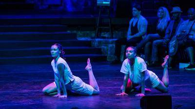 dancers Stephanie Zaletel and Lindsey Lollie on the floor, with one leg bent behind