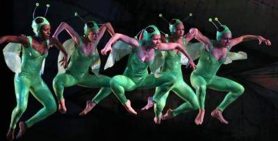 Paul Taylor Dance company members jumping in shiny green leotard and wings