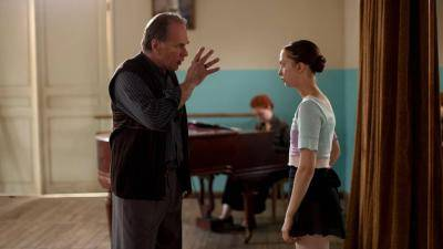 Polina's teacher talking to Polina in the dance class room