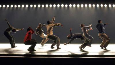 Alvin Ailey dancers in various moves scattered on stage
