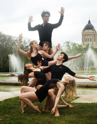 RWBSDC company members posing as a group in front of a fountain