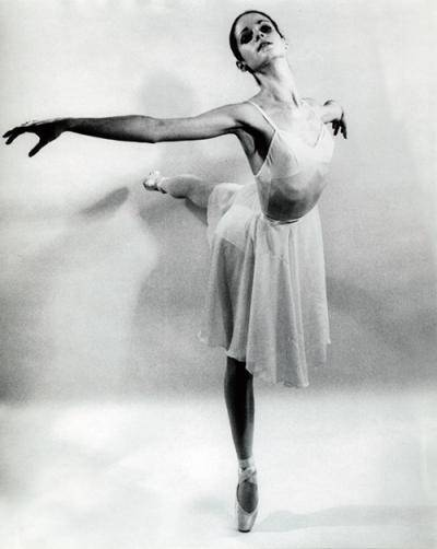 Sharon Savoy in arabesque on pointe in a black and white photo
