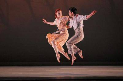 dance couple jumping together, happy feeling