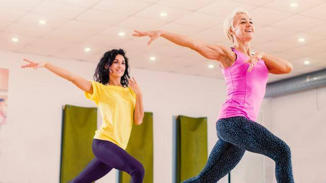two women practicing in a dance studio