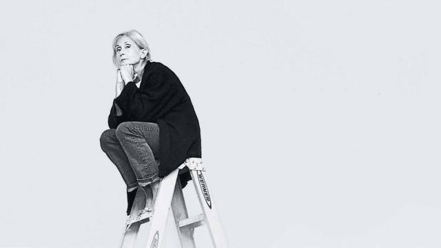 Twyla Tharp sitting at the top of a ladder
