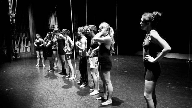 line up of dancers in rehearsal