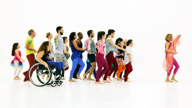A group of people from various walks of life walking together on a white background