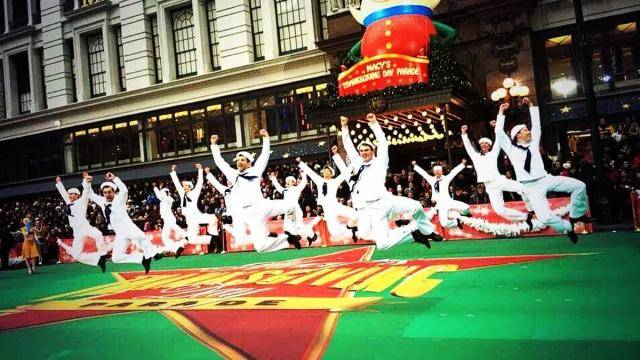 """""""On The Town"""" dancers in a jump at the Macy's Thanksgiving Day Parade"""