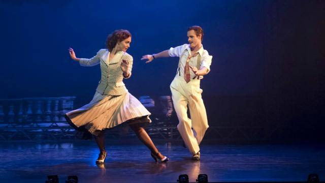 Dancers Ashley Shaw and Sam Archer dancing in a moonlight scene.