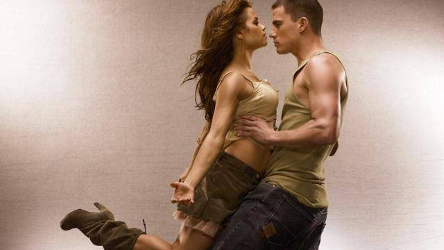 Actress Jenna Dewan  leaning into Channing Tatum's arms from Step Up movie.