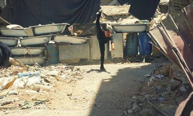 Ahmad Joudeh dances on the rubble of his old refugee camp © Ahmad Joudeh