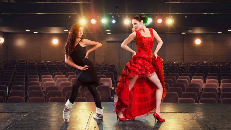 A ballet dancer and a flamenco dancer face off on stage
