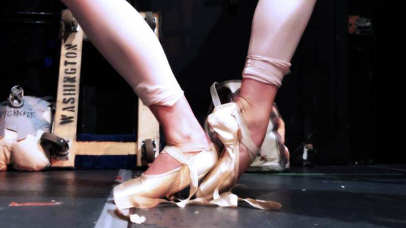 Dancer Samara Rittinger using her heel to step onto the shank of her other pointe shoe.
