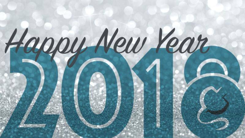 "Grey sparkly background with ""Happy New Year 2018"" on top."