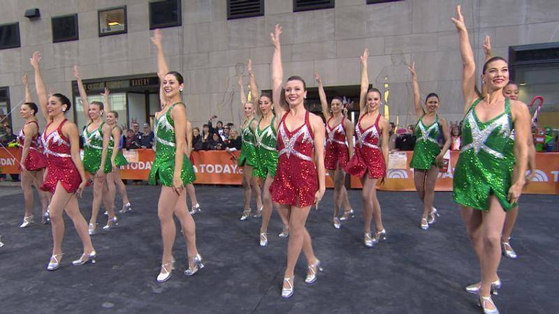 The Rockettes, in red and green sequin dresses, performing 'New York at Christmas' on the TODAY Plaza.